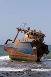 Old ship. In the shallows near the shore Stock Photo