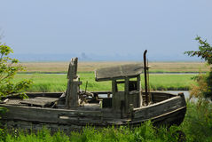 The old ship. Old stranded bood boat near the water Royalty Free Stock Images