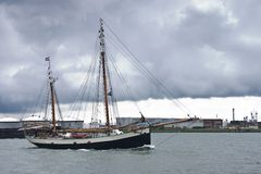 Old ship. Sailing by on the river in the rain Royalty Free Stock Photo