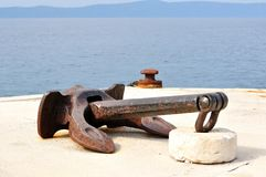 Old ship anchor in port Royalty Free Stock Images