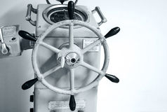 Old ship autopilot with steering wheel Stock Image