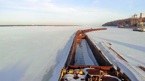 Old ship, barge, on a frozen river, aerial shooting stock video