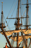 Old ship - Batavia. Details of sail and Jack staff – Batavia – historic galleon by sunset. Old ship Stock Photos