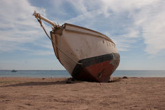Old ship   on  the   beach. Royalty Free Stock Photos