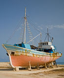 Old Ship being repaired. An old ship by the sea in Cyprus awaiting repair stock photo