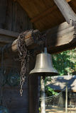 Old ship bell in fishing village, Latvia Royalty Free Stock Photography
