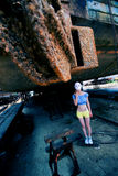 Old ship bottom and masked female Stock Image