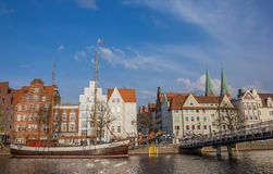 Old ship and a bridge at the quay in Lubeck Royalty Free Stock Photography