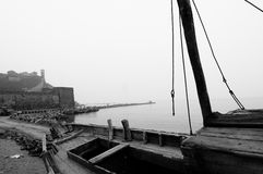 Old ship in Chinese seaport. A black and white view of an old abandoned sailboat or ship on the Chinese seaport of Penglai Royalty Free Stock Photos