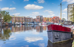 Old ship and colorful apartments in the east harbor of Groningen Stock Image