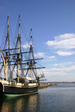 Old ship at dock. Old ship docked in New England harbor Stock Photo