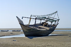 The old ship in the dried up sea Stock Photos