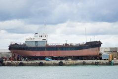 An old ship in a graving dock in Yalta port Stock Photo