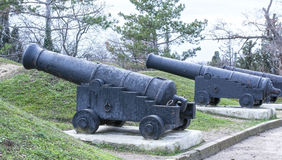 Old ship gun on a coastal position Stock Photos