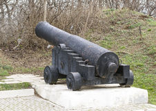 Old ship gun on a coastal position Royalty Free Stock Images
