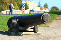 Old ship gun on a wooden gun carriage stock photo