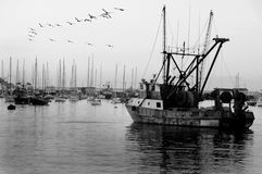 Old ship in harbor. Vintage fishing boat in harbor Stock Photos