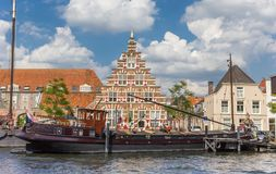 Old ship and historic facade in the center of Leiden. Netherlands Royalty Free Stock Photos