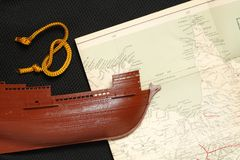 Old ship and map. Royalty Free Stock Photo