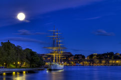 Old ship in moonlight. Vintage vessel under the moon at night stock photos