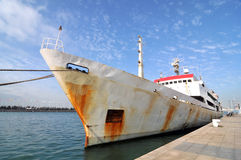 An old ship parked in the dock Stock Image
