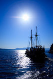 Old ship in the port of Fira. An old ship in the port of Fira (Santorini, Greece) with tourists on board royalty free stock images