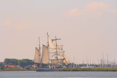 Old ship sailing out Stock Photography