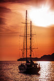 Old ship sailing to the sunset. stock photography