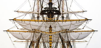 Old ship sails & masts. Kogg masts with ropes and sails royalty free stock image