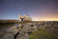 Old ship with star trails Royalty Free Stock Images