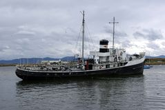 Old ship in Ushuaia. An old ship in the harbor of Ushuaia, in Argentina Royalty Free Stock Photos
