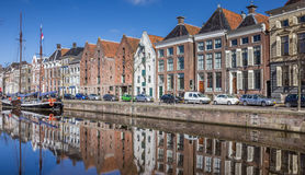 Old ship and warehouses along a canal in Groningen Royalty Free Stock Images
