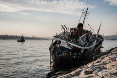 Old Ship Washed Ashore in Bosphorus Stock Image