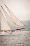 Old ship with white sales, sailing in the sea Stock Images