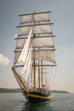 Old ship with white sales, sailing. In the sea Stock Images
