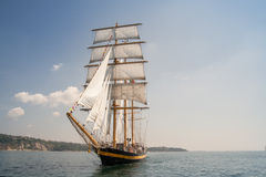 Old ship with white sales. Sailing in the sea Stock Photos