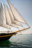 Old ship with white sales, sailing in the sea Royalty Free Stock Image