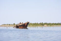 Old ship wreck in the sea Royalty Free Stock Photo