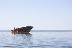 Old ship wreck in the sea Stock Photography