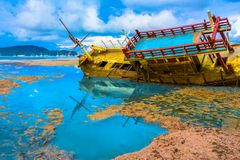 Chalong bay very important for travel business it is a center for all boat and yacht marina. The old ship wreck stuck on the mud near Chalong gulf Stock Photo