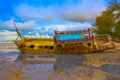 Chalong bay very important for travel business it is a center for all boat and yacht marina. The old ship wreck stuck on the mud near Chalong gulf Stock Photography