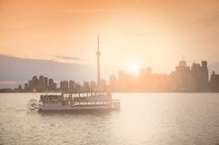 Old ship with young people on the rest at sunset time. Royalty Free Stock Photo