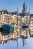 Old ships and church tower along a canal in Groningen Royalty Free Stock Photo