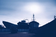 Old ships in Essaouira harbour, hipster style Stock Images