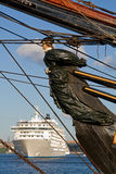 Old ships figurehead and modern cruiseship. Old wooden ships figurehead with modern cruiseliner in the background stock images