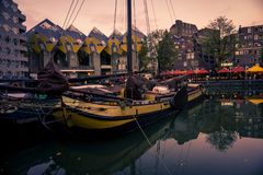 Old ships in harbor, cubic houses, Rotterdam stock photography