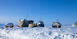 Old ships on the ice of  Lake Baykal Royalty Free Stock Images