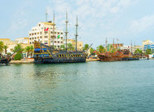 The old ships in modern city Stock Photo