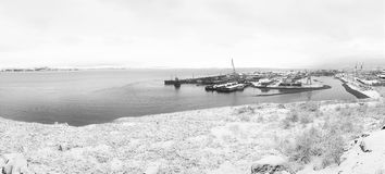 Old ships in the seaport. Winter coast. Black and white photography Stock Photo