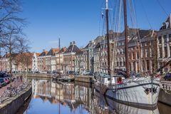 Old ships and warehouses along a canal in Groningen Stock Images